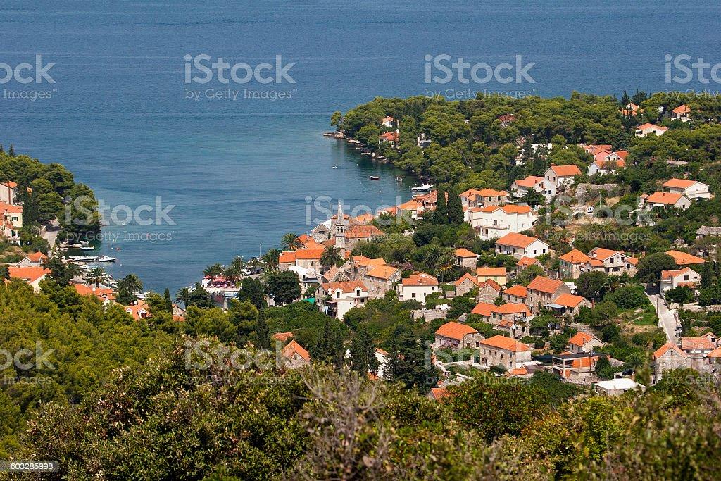 Houses in Splitska between pine and olive trees stock photo