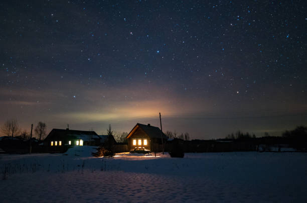 Houses in the Russian village. Winter, frosty night. Starry sky over the roofs of houses. Houses in the Russian village. Winter, frosty night. Starry sky over the roofs of houses. russian dacha stock pictures, royalty-free photos & images