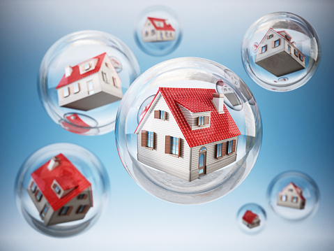 Houses inside clear bubbles. Isolation or quarantine concept.