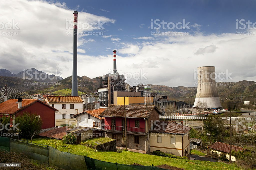 Houses near a power plant. stock photo
