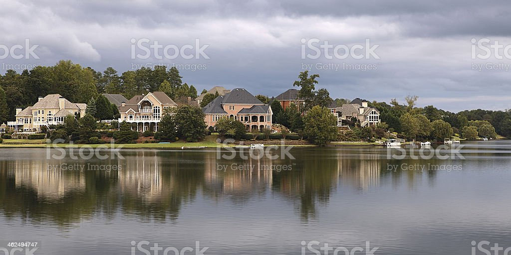 Houses near the lake stock photo