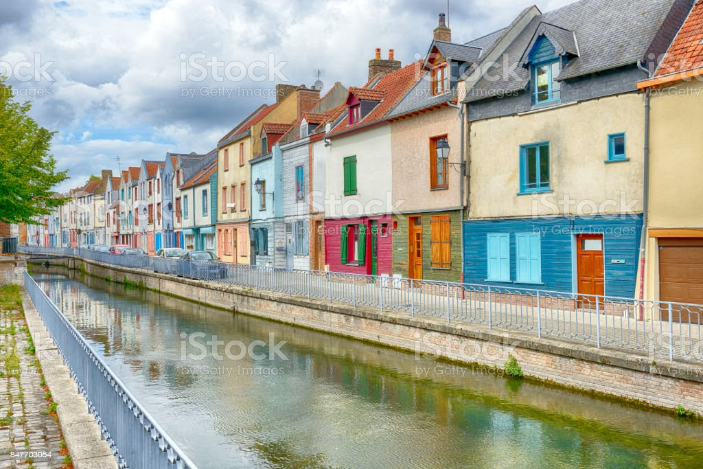 Houses next to canal or river in Amiens stock photo