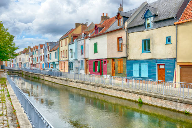 Houses next to canal or river in Amiens Houses next to canal or river in Amiens. The canal de la somme, somme department, Picardy, France. somme stock pictures, royalty-free photos & images
