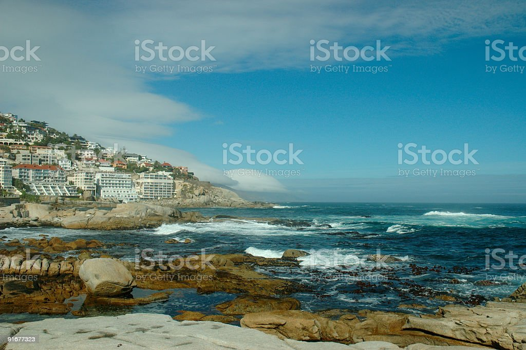 Houses, ocean and rocks royalty-free stock photo