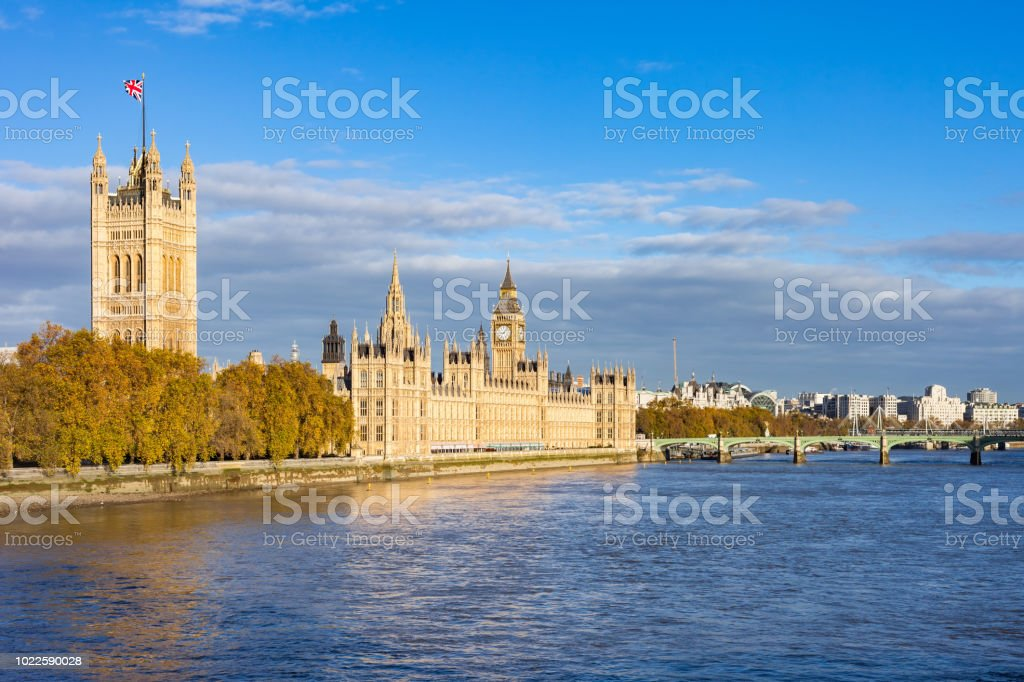 Houses of Parliament and Thames River in London England UK stock photo