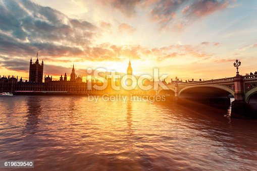 Houses of Parliament and Westminster Bridge at sunset in London, United Kingdom.