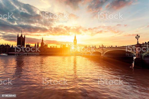 Photo of Houses of Parliament and Westminster Bridge at sunset in London