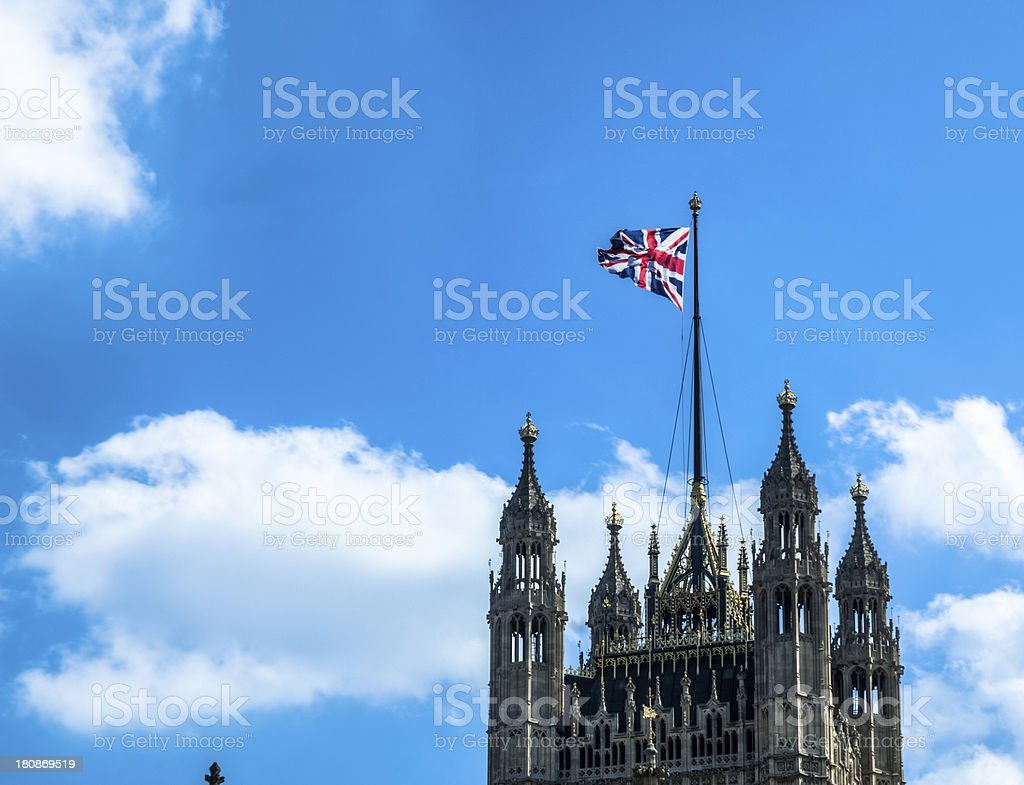 Houses of Parliament, Victoria Tower with Flag Flying in Breeze royalty-free stock photo