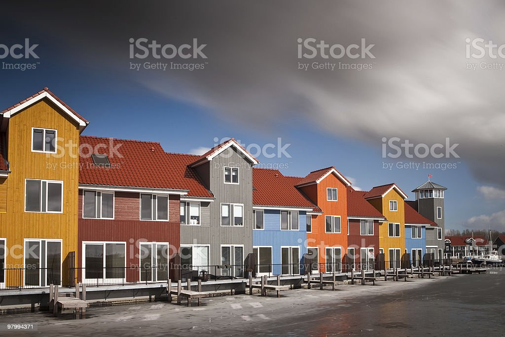Houses of wood in violent colours royalty-free stock photo