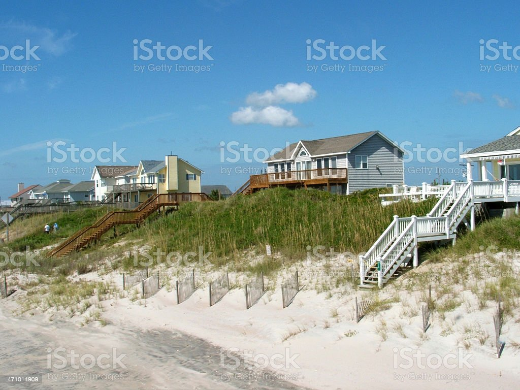 Houses on a hill leading onto a beach stock photo