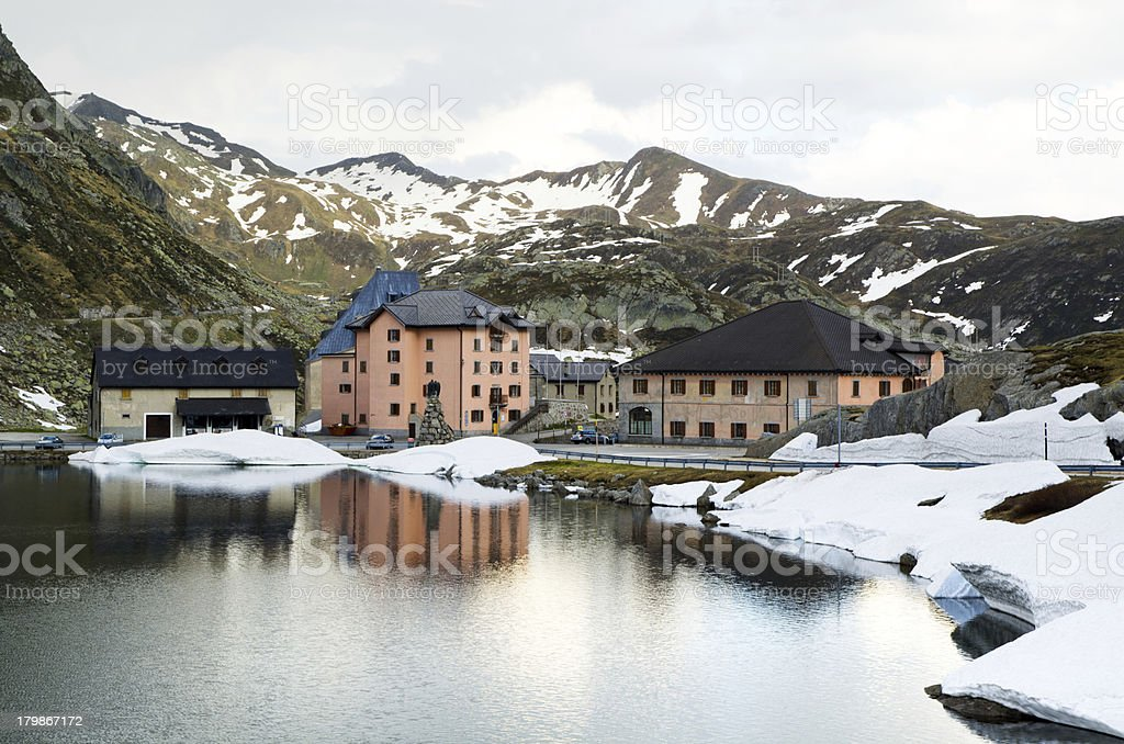Houses on a lake front with snow-capped mountains stock photo