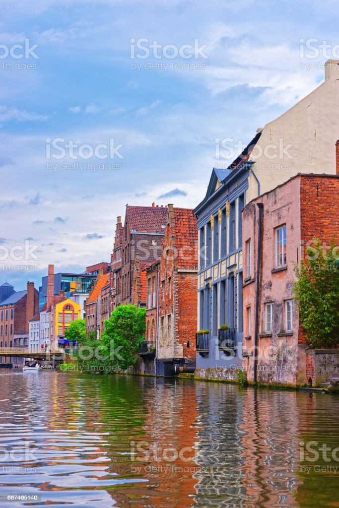 Houses on Graslei and Korenlei over Lys River Ghent stock photo