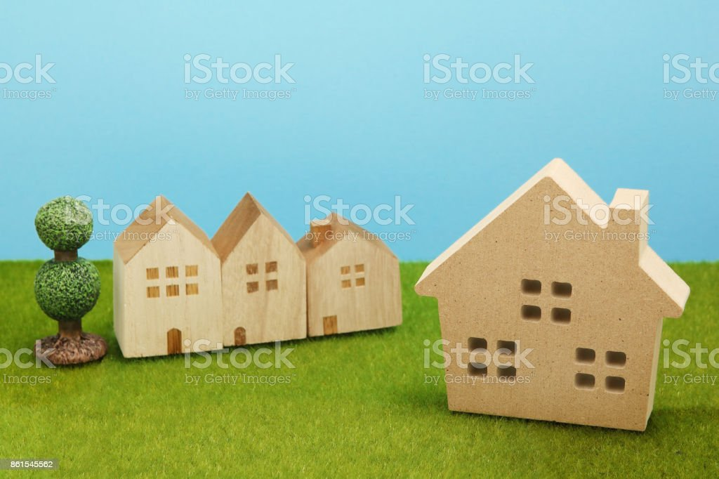 Houses on green grass over blue sky. stock photo