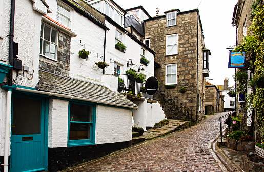 Houses on steep road in English town