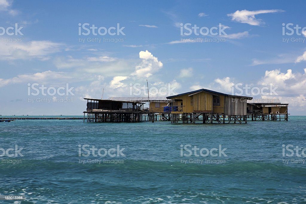 Houses on stilts in the sea stock photo