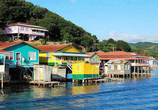 "Houses on the coast of Roatan, Honduras ""Houses built in stilts along the coast of Roatan, Honduras."" honduras stock pictures, royalty-free photos & images"