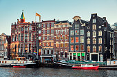 Beautiful houses over a canal in the center of Amsterdam. City landscape.