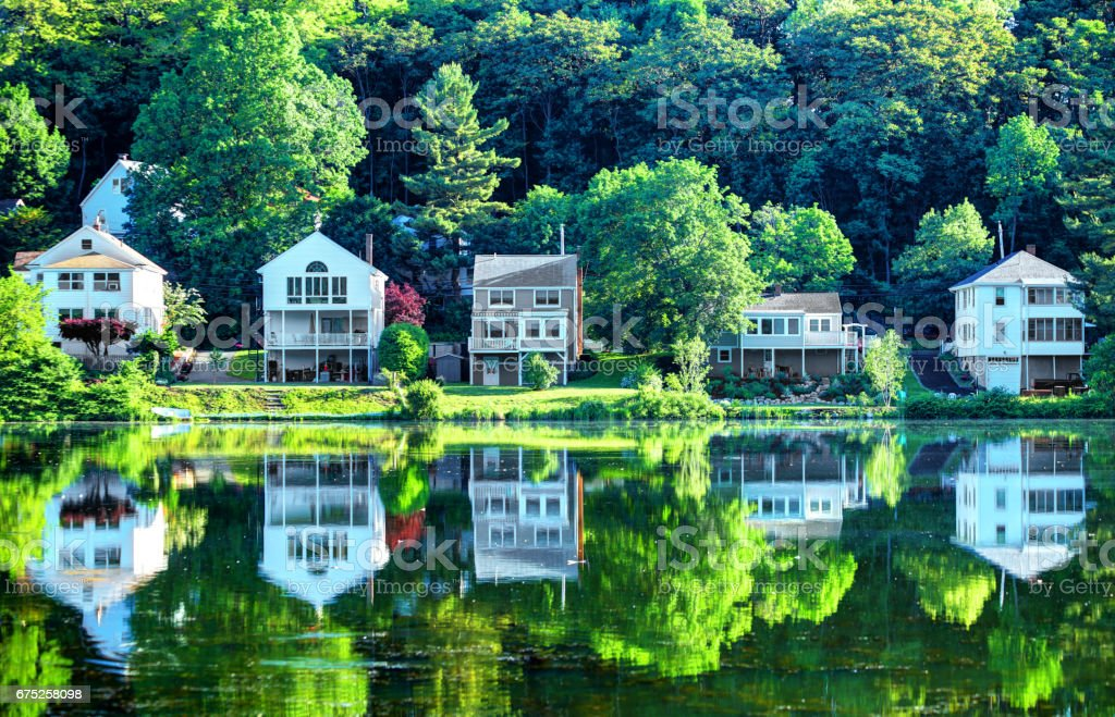 Houses reflecting on a small pond in Boston's Brighton neighborhood. stock photo