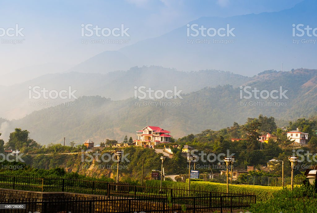 houses surrounded by hills in Himachal India stock photo