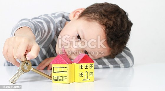 istock houses with keys and little boy 1086984882