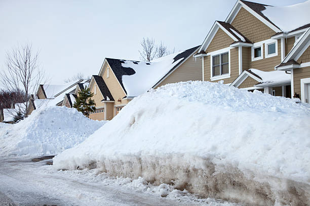 houses with snow piled up in front - snow pile stock photos and pictures