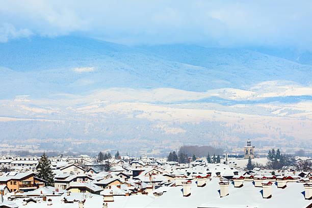 Houses with snow roofs panorama in bulgarian ski resort Bansko stock photo