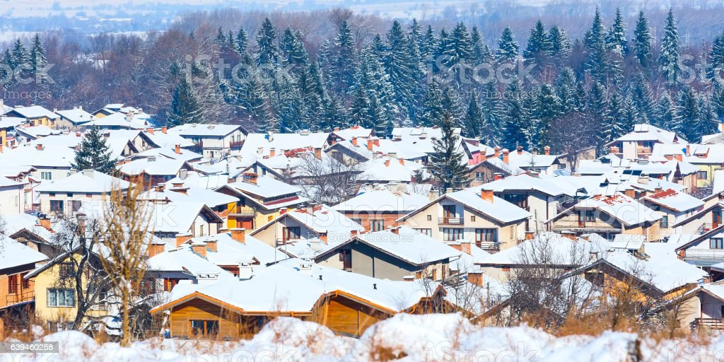 Houses with snow roofs panorama in bulgarian ski resort Bansko stock photo
