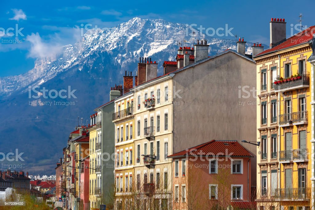 Houses with tiled roofs and pipes Grenoble, France stock photo