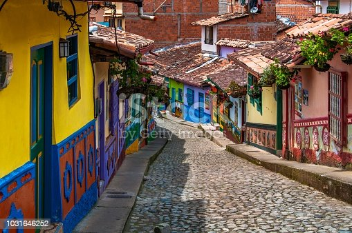 istock Houses with wall painted in colourful emblems or symbols representing the people living at Guatape, near Medellin, Colombia. 1031646252