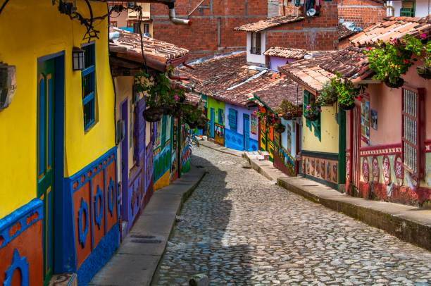 houses with wall painted in colourful emblems or symbols representing the people living at guatape, near medellin, colombia. - colombia stock photos and pictures