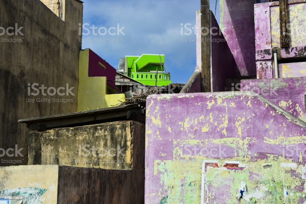 Houses with weathered bright colorful walls stock photo