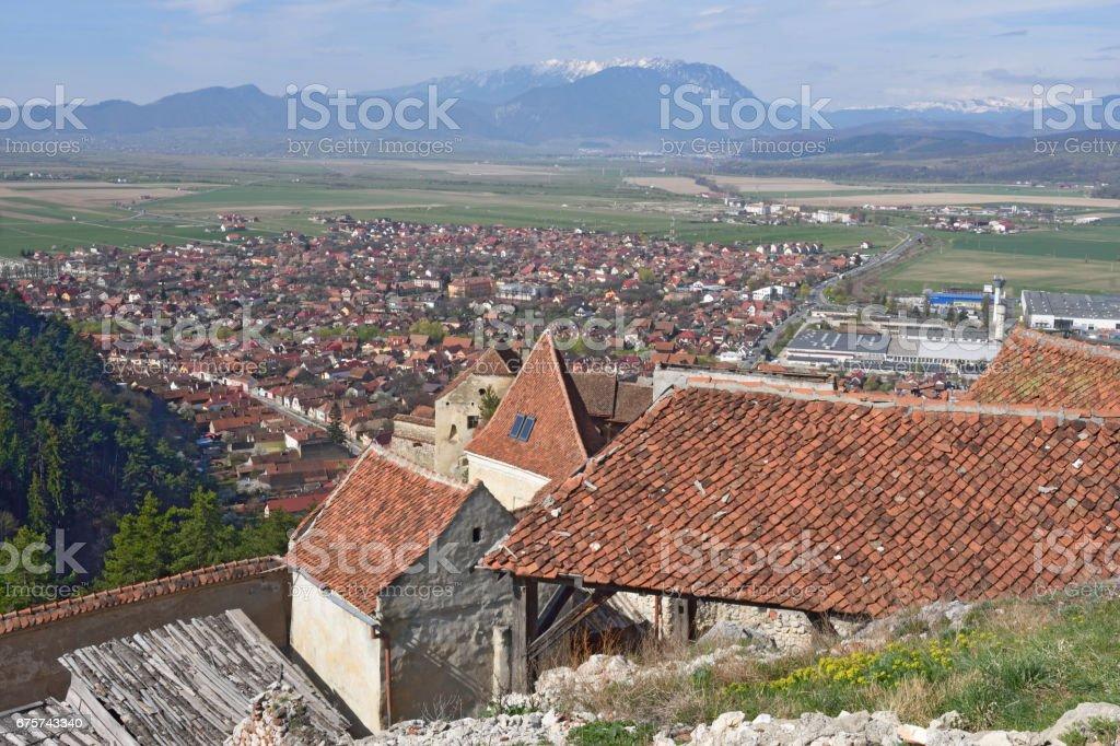 Houses within the Citadel of Rasnov in the background the City, Transylvania, Romania stock photo