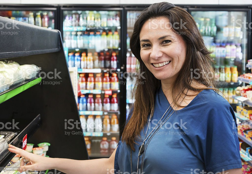 Housewife at the supermarket stock photo