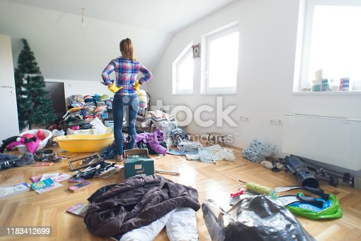 Young housewife preparing for cleaning clutter at home.