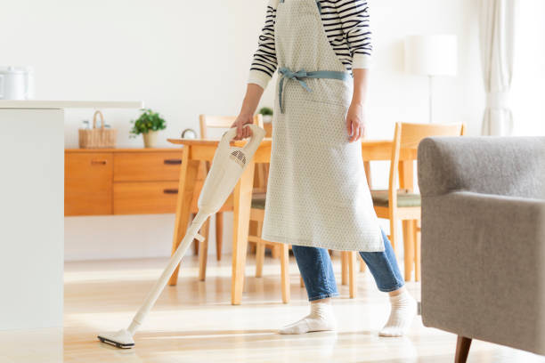 housewife cleaning with vacuum cleaner - stay at home parent stock pictures, royalty-free photos & images