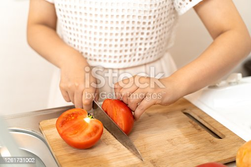 619063596 istock photo Housewife cooking in the kitchen 1261731002