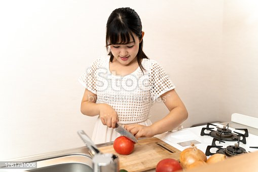 619063596 istock photo Housewife cooking in the kitchen 1261731006