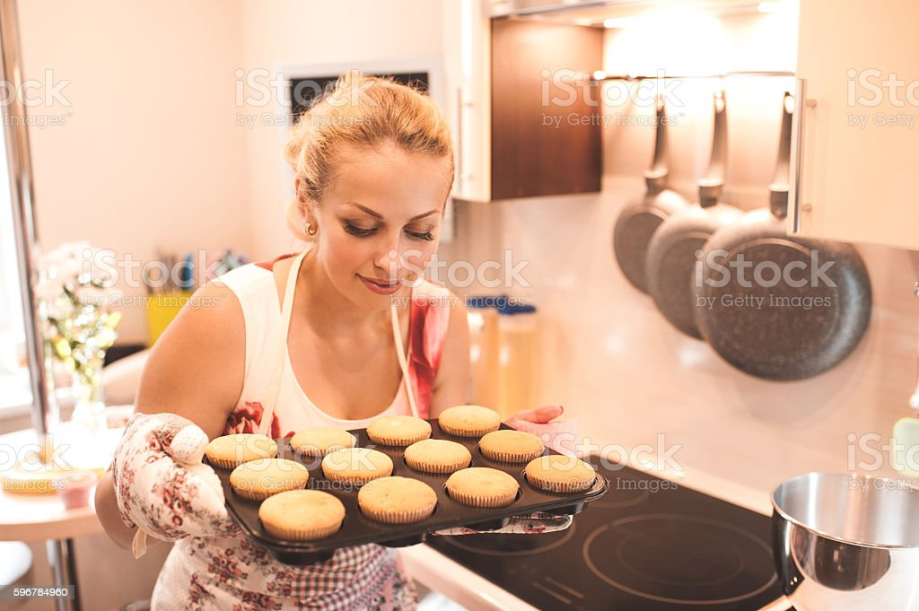 Housewife cooking muffins indoors stock photo