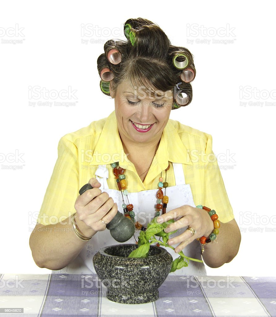 Housewife Crushing Herbs royalty-free stock photo
