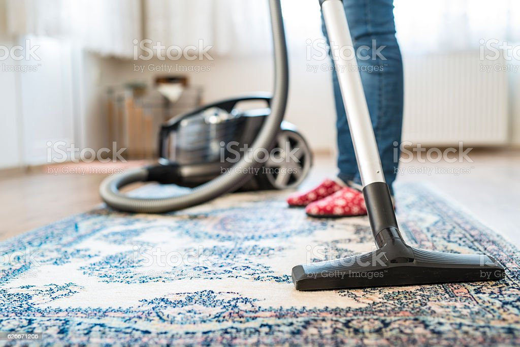 Housewife doing housekeeping in the room - foto stock