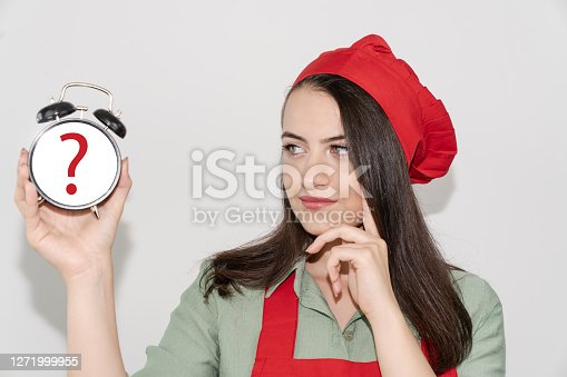Housewife female chef cook or baker in red apron, toque chefs hat isolated on white background. alarm clock cook woman question mark