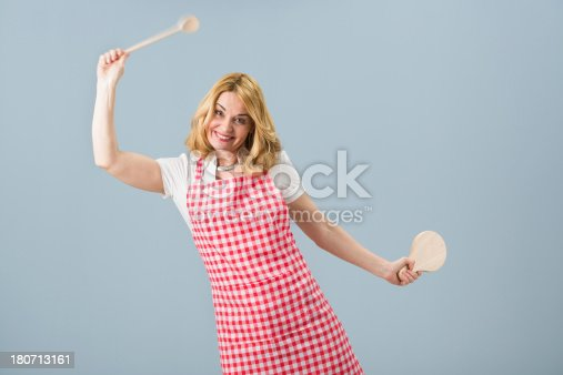 istock Housewife holding mixing spoon and cutting board 180713161