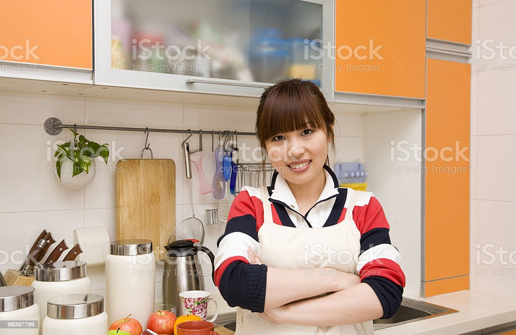 housewife in her kitchen royalty-free stock photo
