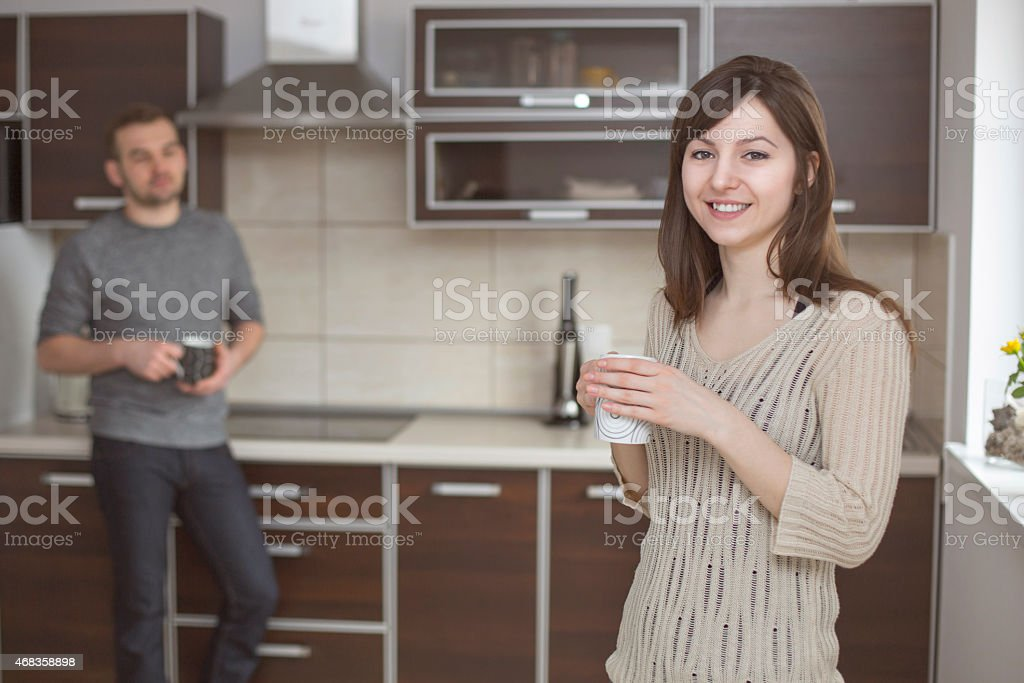 Housewife in kitchen with coffee royalty-free stock photo