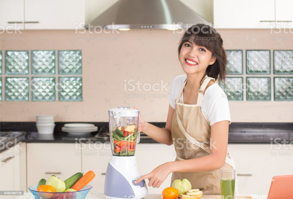 Housewife in the kitchen and ordering stuff online store for cooking stock photo