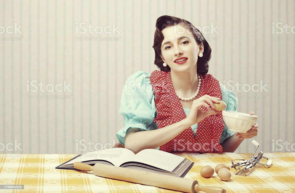 Housewife in the kitchen stock photo