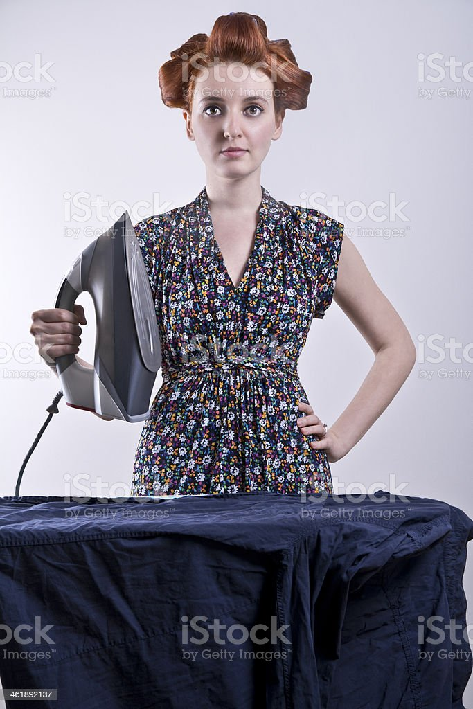 housewife ironing clothes royalty-free stock photo