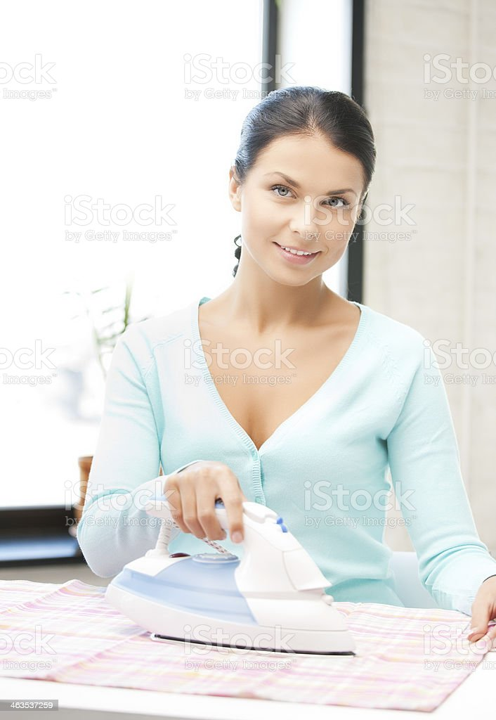 housewife ironing clothes stock photo