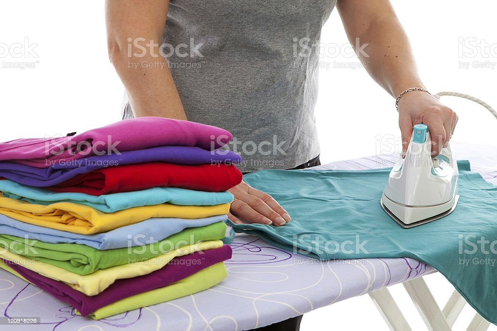 housewife is doing the ironing stock photo