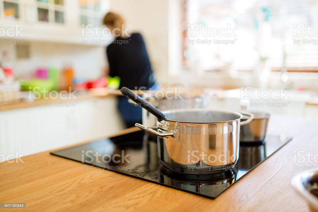 Housewife making lunch in kitchen stock photo